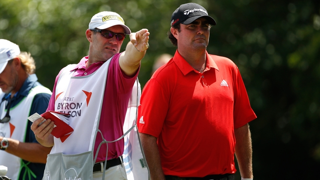 Steven Bowditch confers with caddie Neil Wallace on the 15th