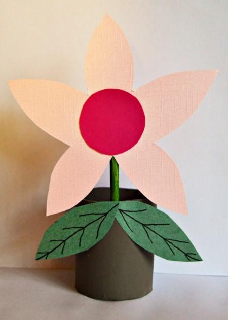 toilet paper roll in a flower pot