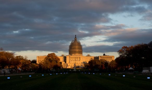 The U.S. Capitol Building illuminated by the setting sun on the National Mall in Washington, DC, on Nov. 11, 2014. (AP Photo/Carolyn Kaster)