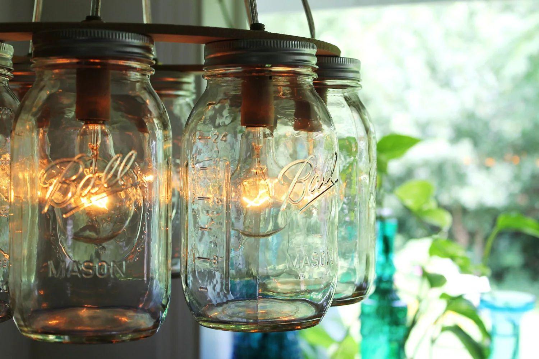 Mason jar chandelier mason jar light wagon wheel by bootsngus