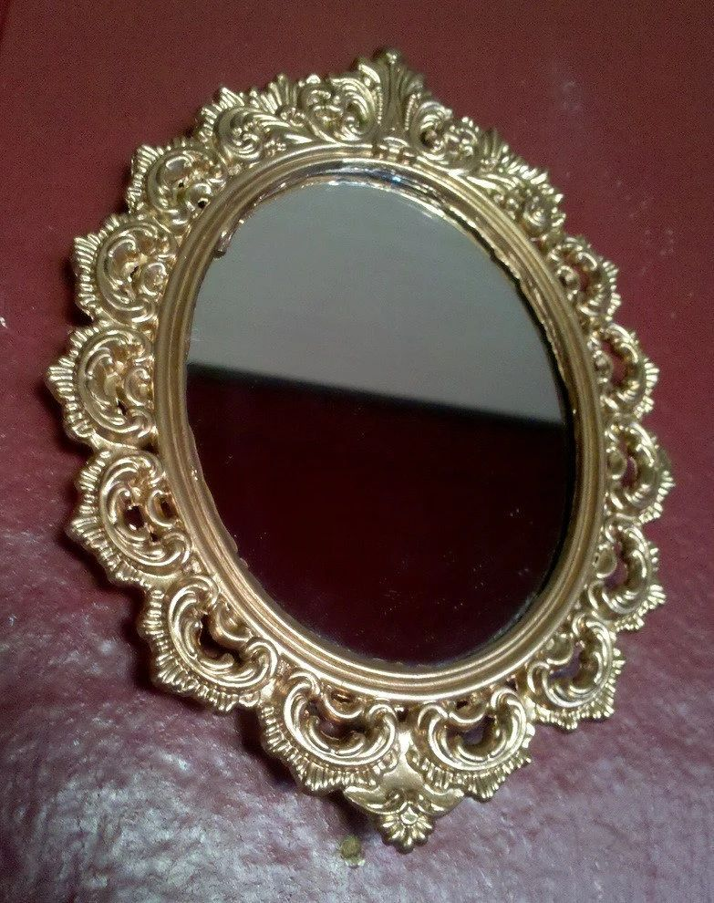 Tiny mirror in vintage victorian frame ornate oval in rosy