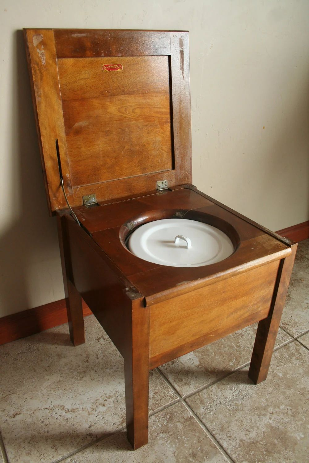 Antique commode chair wood with white and blue porcelain chamber pot