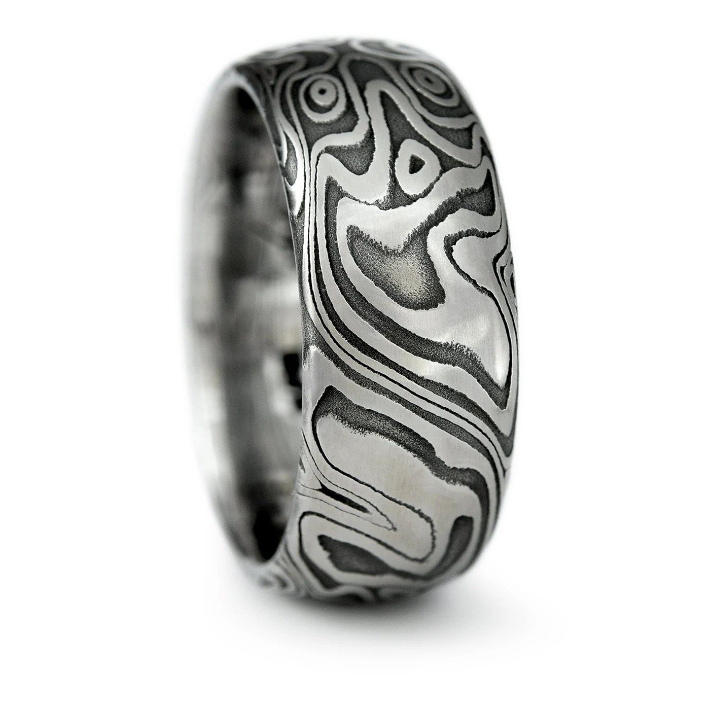 damascus steel ring with white gold damascus wedding band Damascus Steel Domed Wedding Band with Four Pointed Swirling Star Pattern with Dark Fire Patina Bold Masculine Handmade Wedding Ring