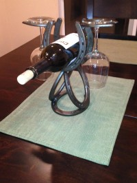 Horseshoe wine rack. Single Wine bottle that holds 2 wine