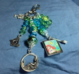 Go under the sea with this Little Mermaid - Ariel inspired zipper pull/backpack decoration/purse charm!