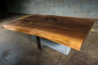 Live edge black walnut coffee table on concrete and steel