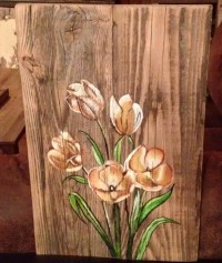 Flower painted on old wood barn