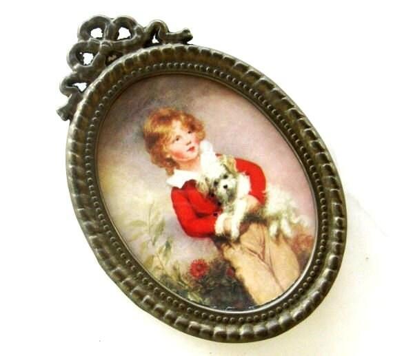 Vintage oval metal frame miniature victorian boy dog ornate