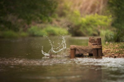 Fishing Dock with fishing net by the creek/water with and