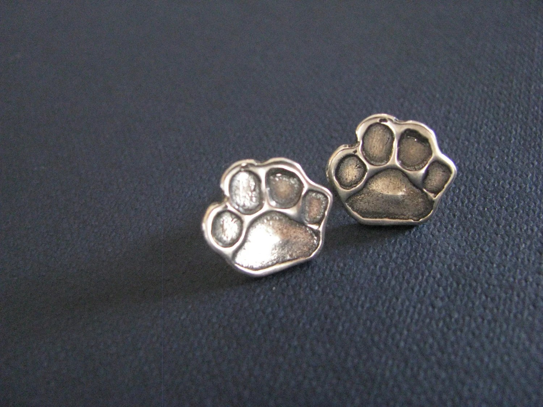 Sterling silver paw print stud earrings. Paw print post
