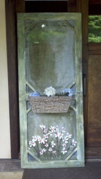 old screen door / decorative with a planter box on the front