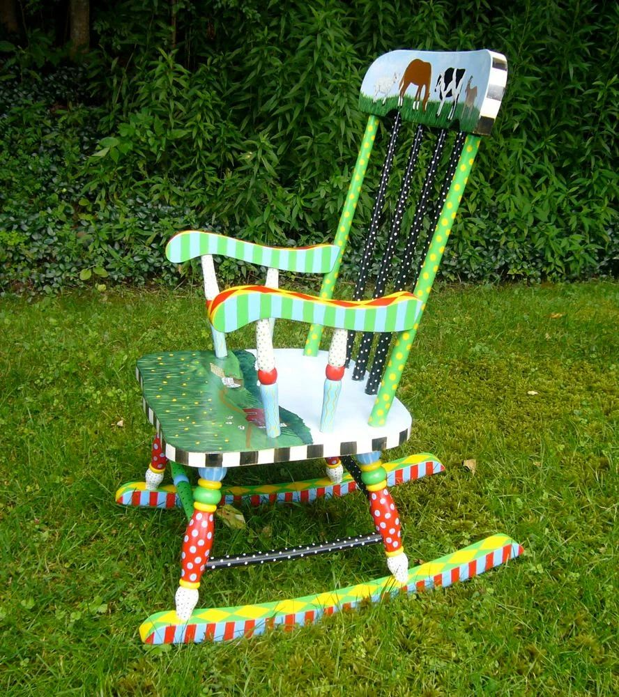 Hand painted child s rocking chair in bright colors by