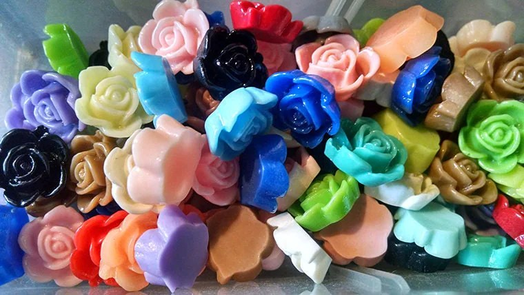 photo of multicolored flower cabochons