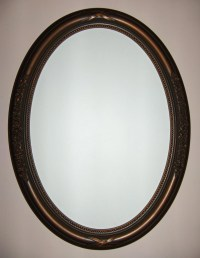 Oval mirror with oil rubbed bronze color frame. bathroom