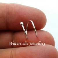Silver double piercing earring. 18g. Two hole earring. Spiral