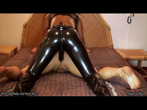 dominatrix in leather boots bound