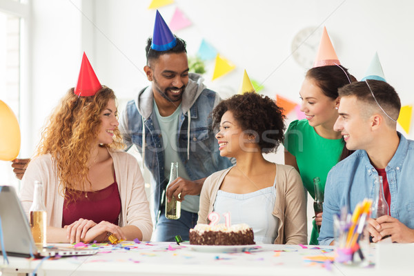 team greeting colleague at office birthday party stock photo © Syda