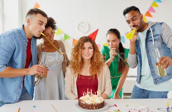 happy coworkers with cake at office birthday party stock photo