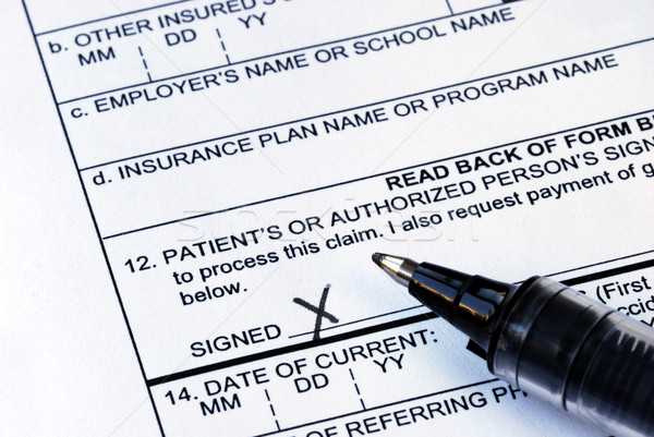 The patient signs the medical claim form stock photo © Yukchong - medical claim form