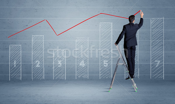Man drawing chart from ladder stock photo © Rancz Andrei (ra2studio