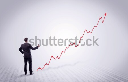 Standing businessman with red graph arrow stock photo © Rancz Andrei