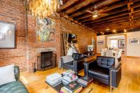 A 32-Foot Long Living Room with Exposed Brick Dominates ...