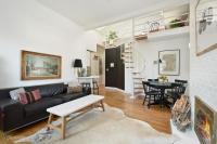 Hip loft with vaulted ceilings and a private roof deck ...