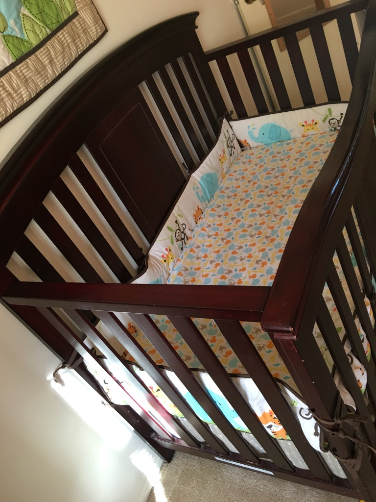 Baby s brown wooden crib