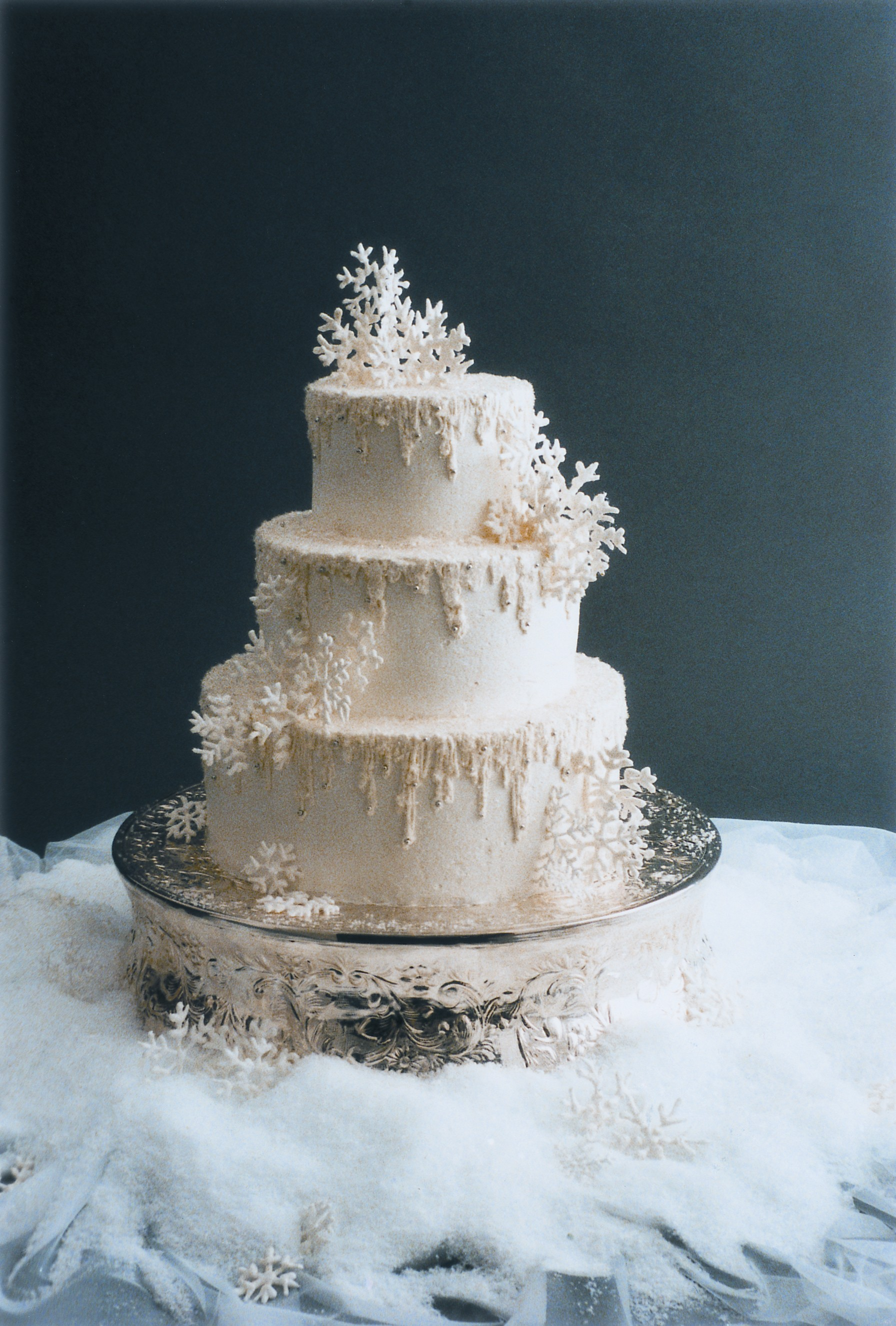 finish your wedding centerpiece fake wedding cakes Frosted Italian Buttercream icicles and fake snow finish this winter wedding cake