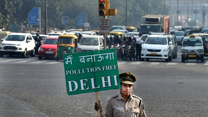 "A cop holding a sign that reads, ""I will make Delhi a pollution free city"" (Image by Delhi government)"