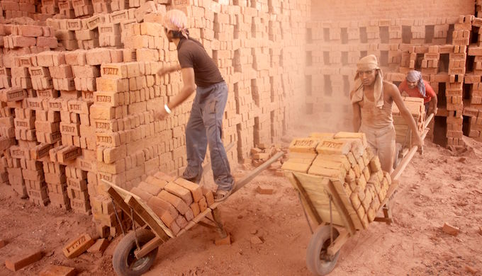 Men working at a brick kiln (Photo by International Labour Organization)