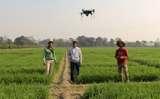 Testing a drone over wheat fields in Pusa, Bihar. (Photo by Manish Kumar)
