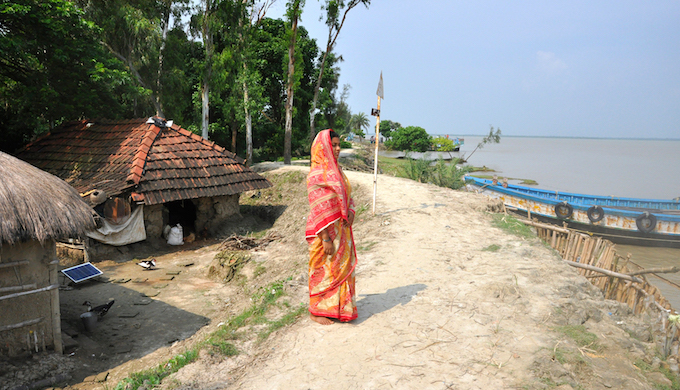 "Mamata Bibi has been married into a family that had changed address five times, forced by the rising water. Now her family is searching for a new destination, preferably outside Ghoramara, as the present dwelling has come perilously close to the advancing river. ""We do not know how long this house will survive. My brother-in-law, his wife and my husband have gone to scout for a piece of land outside Ghoramara,"" says Mamata."