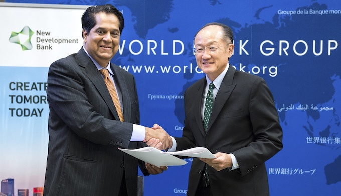 World Bank President Jim Yong Kim and New Development Bank President K.V. Kamath after signing an agreement in September. (Photo by World Bank)