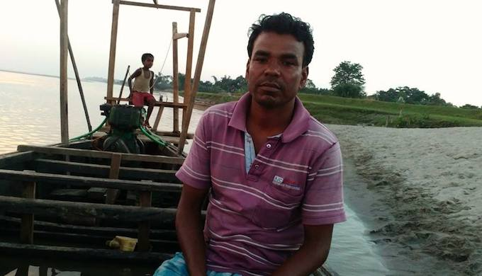 Abdul Mazid is a boat man on Jia Bhoroli, a major tributary of the Brahmaputra river in Assam. (Photo by Teresa Rehman)