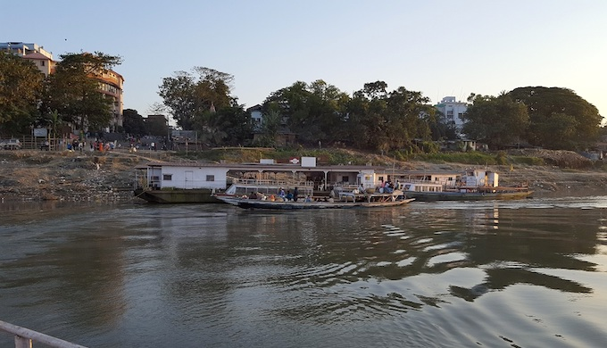 The riverfront is a zone of economic activity, and also a trash dumping site. (Photo by Omair Ahmad)