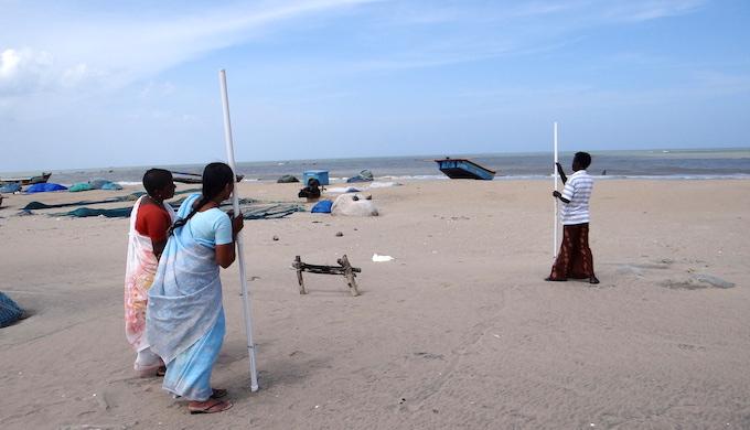 Volunteers taking readings to map the shoreline. (Photo by Vivek Coelho)