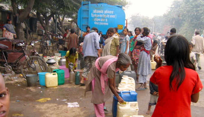 People collecting drinking water from a truck in India. (Photo by Jankie)