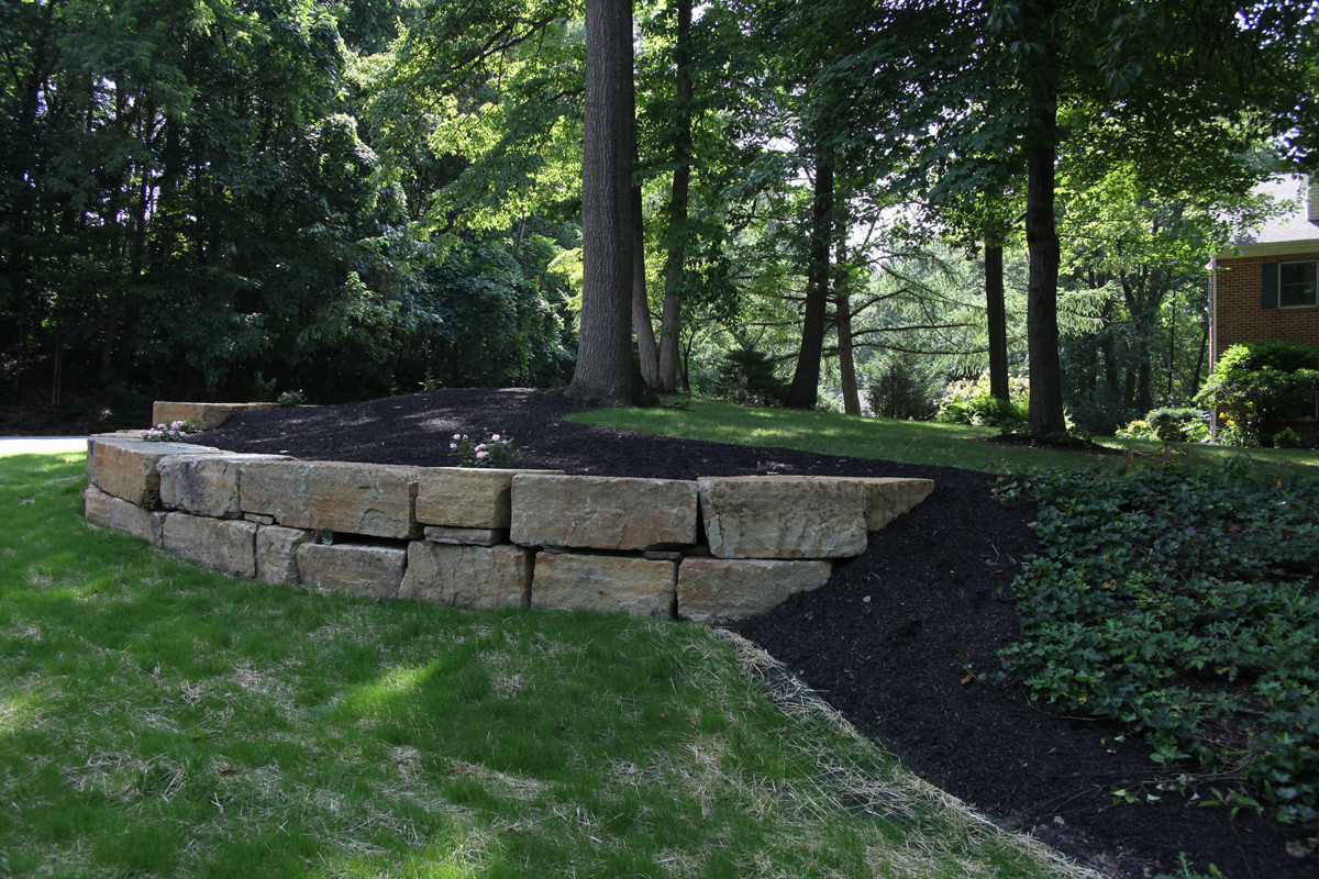 Indian Run Landscaping  Natural Boulder Retaining Wall