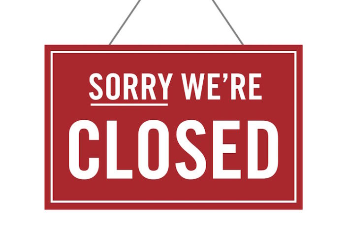 "An image of a red sign that reads, ""Sorry, we're closed."""