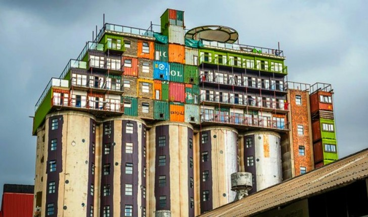 Silos Topped With Stacks Of Shipping Containers Provide