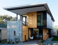 Two compact modern homes fill challenging empty lots in an ...