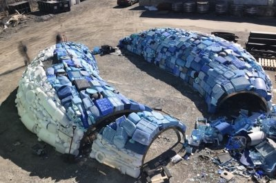A massive five-ton plastic waste whale breaches in a Bruges canal | Inhabitat - Green Design ...