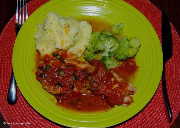 - A Jamie Oliver recipe -- Baked white fish (mahi-mahi) with olives and tomato sauce served with creamy mashed potatoes and steamed broccoli.
