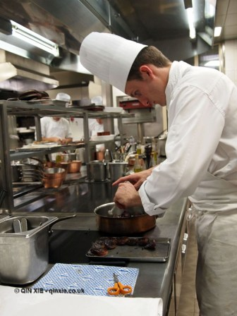 Chef making caramelised onions, 25th Anniversary Celebration Menu at Alain Ducasse's Le Louis XV in Monte Carlo, Monaco