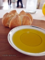 Sharing bread, ginger and lemon olive oil, Mirazur, Menton
