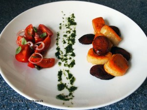 Potato gnocchi with chorizo, basil oil and tomato salad