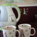 Peter Rabbit kettle and cups and Peter Rabbit wall paper