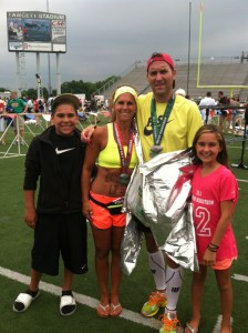 After finishing the Canton marathon, Heinz Pak celebrated with his wife, Lori, and children, Bailey, 16, and Sydney, 12.