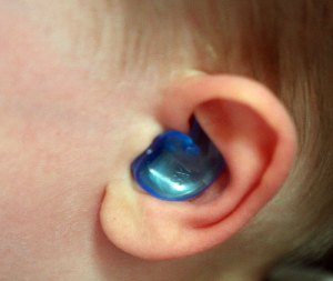 Ear plugs help protect the ear during bathing and showering.